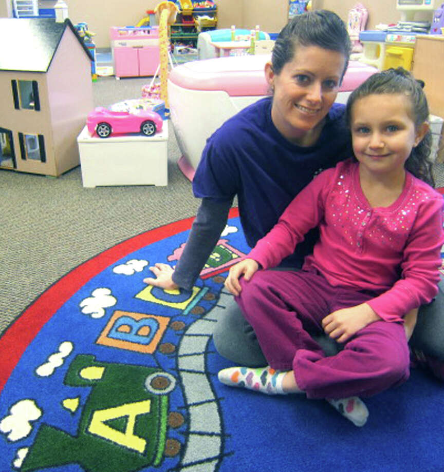 Jennifer Benedict brings 22 years' experience in child care to her new business - Kids In Action. On some days off from school, her 6-year-old daughter, Jamee, accompanies Ms. Benedict to the welcoming New Milford center. February 2013 Photo: Norm Cummings