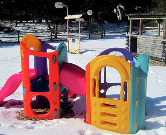 Once the weather warms up, the business' large playground will be a popular destination for children being cared for at Kids in Action. February, 2013 Photo: Norm Cummings