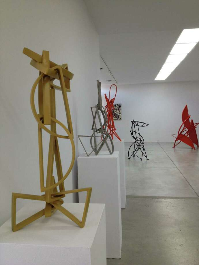 "Mac Whitney's kinetic ""Tioga"" (yellow painted steel, 27 x 12 x 13 inches) and other works on view at Gallery Sonja Roesch. Photo: Molly Glentzer"