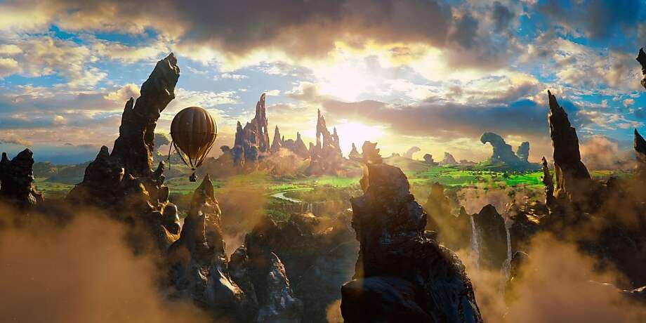 """Oscar Diggs' hot air balloon sails over the land of Oz in Sam Raimi's fantasy film """"Oz: The Great and Powerful,"""" a prequel to """"The Wizard of Oz."""" Photo: Film Still"""