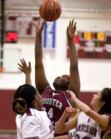 Wooster's Venus Okwuka scores off an offensive rebound in the HVAL playoff semifinal against Darrow Wednsday at Wooster School in Danbury. Photo: Barry Horn / The News-Times Freelance