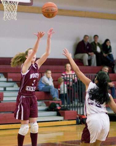 Wooster's Kate MacNutt shoots from the outside over Darrow's Marianne DeChavez in the HVAL playoff semifinal game Wednesday at Wooster School in Danbury. Photo: Barry Horn / The News-Times Freelance