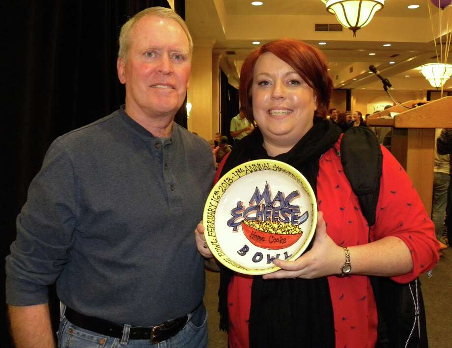 STEVE BARNES/TIMES UNION  Jill Kavanagh of Troy won the home-cooks category at last weekend's timesunion.com/Table Hopping Mac-n-Cheese Bowl with coaching from her father, Dennis.