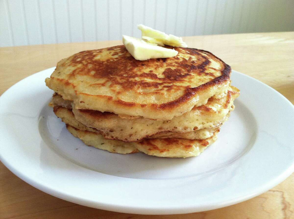 """""""The New Comfort Food"""" offers a pancake recipe from a classic New Hampshire diner, and this time-tested formula has a crazy amount of leavening, which quickly turns the batter into a delicious, doughy, sticky, air bubble-filled mass. (Rick Nelson/Minneapolis Star Tribune/MCT)"""
