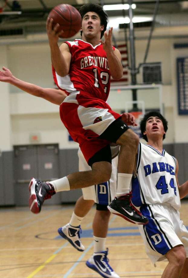 Greenwich High School's Mike Lefflebine drives past Darien's Mike Lee during Wednesday evenings championship game of the LaVista Tournament which is held annually at Darien High School.  The Cardinal's went on to win 55-38. Photo: David Ames, David Ames/For Greenwich Time / Greenwich Time