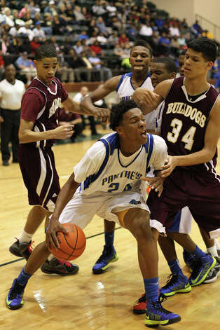 Ozen's Christian Bolton, No. 24, attempts to drive to the basket during the 58-47 win over Summer Creek in the Class 4A bidistrict playoff game at Buccaneer Gym in Winnie, TX. (Matt Billiot / Special to the Enterprise)
