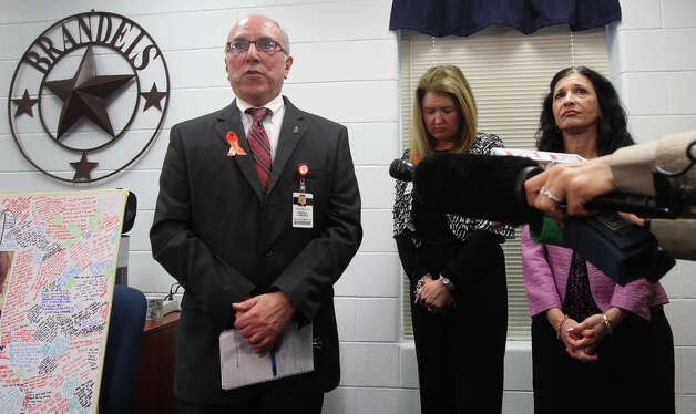 Northside Independent School District spokesman Pascual Gonzales (left) speaks with the media Wednesday February 20, 2013 at Brandeis High School about the fatal car crash that took place yesterday at the Loop 1604 access road and West Hausman Road. Standing in the center is Brandeis High School principal Geri Berger and on the right is Dr. Deborah Healy, Director of Guidance and Couseling for NISD. Photo: San Antonio Express-News