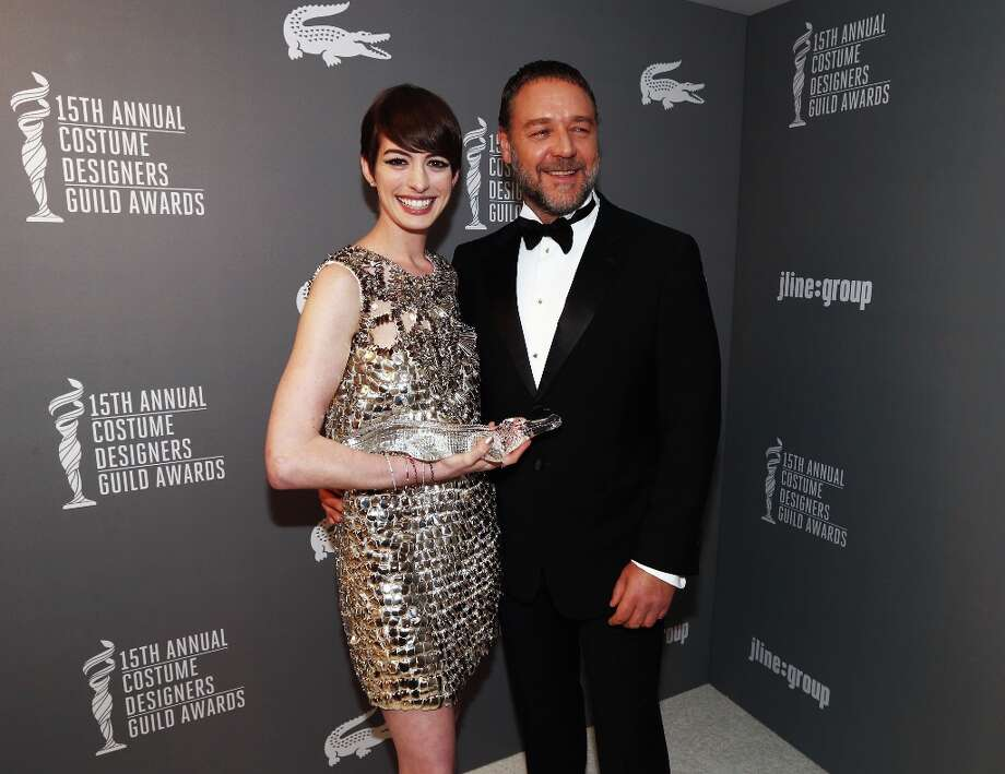 Spotlight Award recipient Anne Hathaway (L) and presenter Russell Crowe attend the 15th Annual Costume Designers Guild Awards with presenting sponsor Lacoste at The Beverly Hilton Hotel on February 19, 2013 in Beverly Hills, California. Photo: Christopher Polk, Getty Images For CDG / 2013 Getty Images