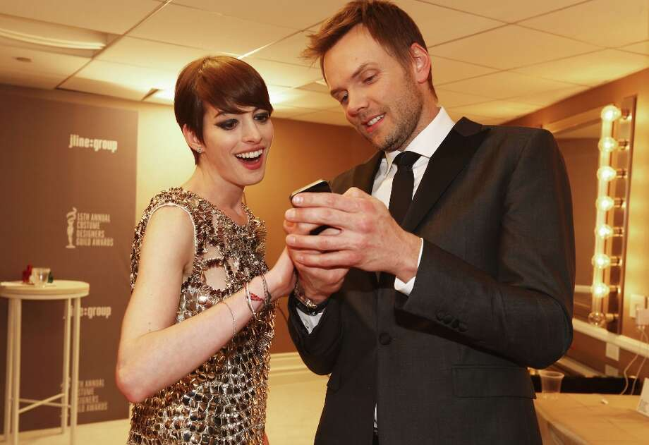 Actors Anne Hathaway (L) and Joel McHale attend the 15th Annual Costume Designers Guild Awards with presenting sponsor Lacoste at The Beverly Hilton Hotel on February 19, 2013 in Beverly Hills, California. Photo: Christopher Polk, Getty Images For CDG / 2013 Getty Images