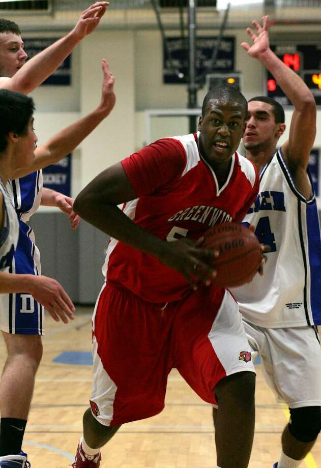 Greenwich High School's Al Azulphar drives to the hoop during Wednesday eveings championship game of the LaVista Tournament that is held annually at Darien High School. The Cardinals defeated Darien 55-38 to win the tournament. Photo: David Ames, David Ames/For Greenwich Time / Greenwich Time
