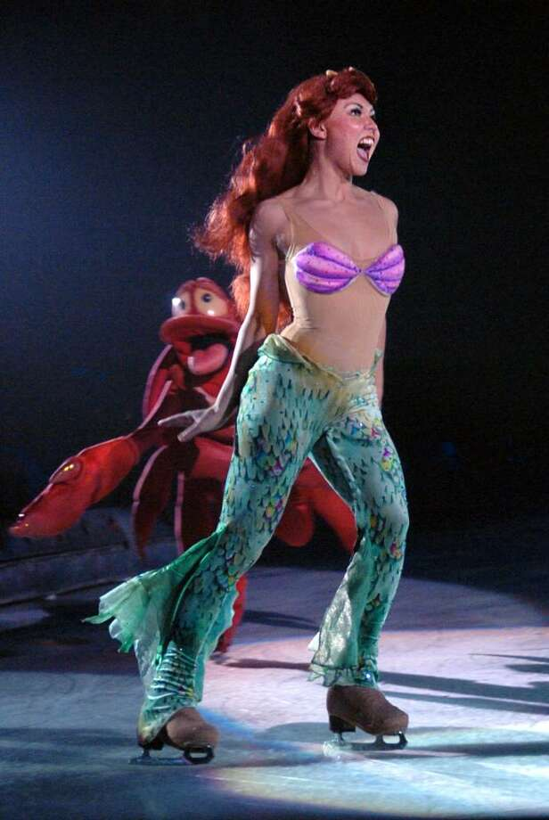 The Little Mermaid Ariel skates across the ice during Disney on Ice Princess Classics Wednesday night at Bridgeport's Arena at Harbor Yard. Photo: Autumn Driscoll / Connecticut Post