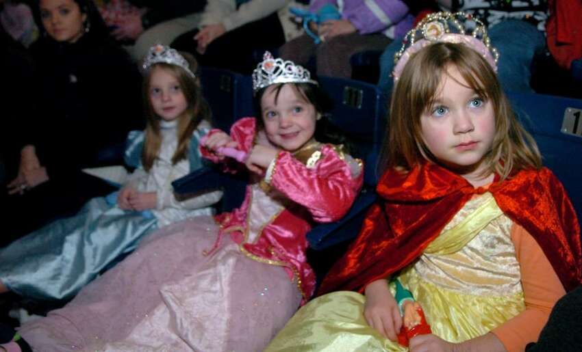 Five-year-olds, from left, Kari Boyle, Hailey Boyle and Ellie Clay, all of Milford, dress like princesses to see Disney on Ice Princess Classics Wednesday night at Bridgeport's Arena at Harbor Yard.