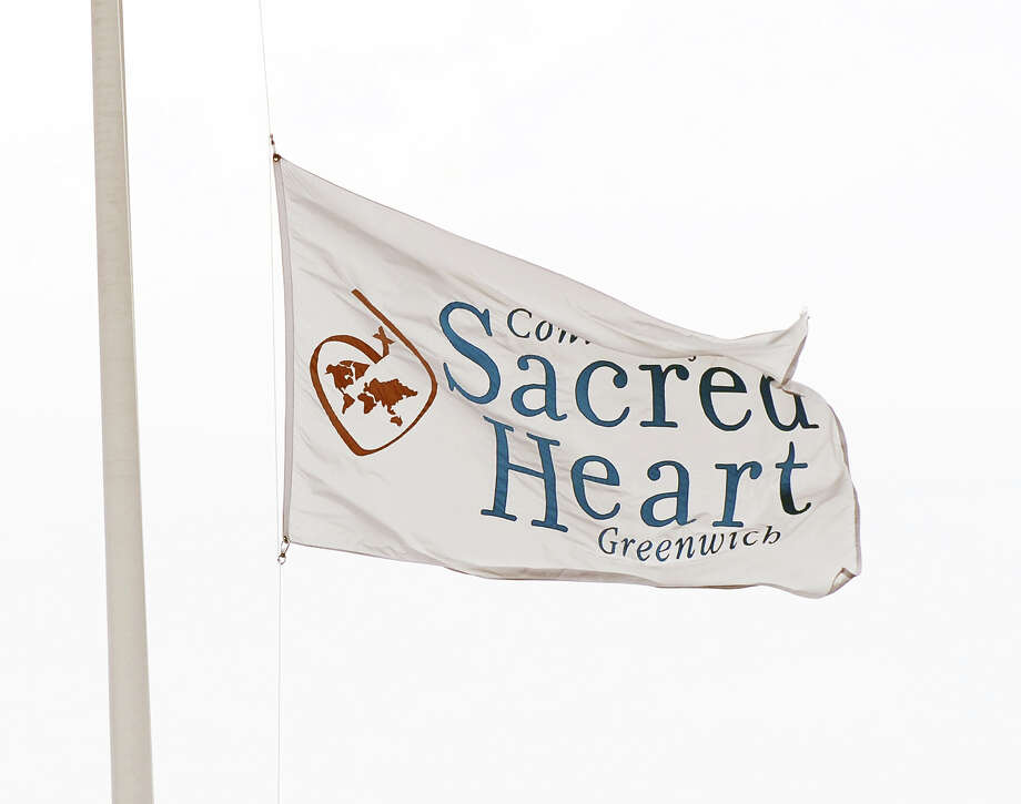 The Convent of the Sacred Heart School flag flys over the school in Greenwich, as seen during graduation, June 1, 2012. Photo: Bob Luckey / Greenwich Time