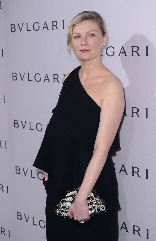 Actress Kirsten Dunst, wearing BVLGARI, arrives at the BVLGARI celebration of Elizabeth Taylor's collection of BVLGARI jewelry at BVLGARI Beverly Hills on February 19, 2013 in Los Angeles, California. Photo: Mark Davis, Getty Images / 2013 Getty Images