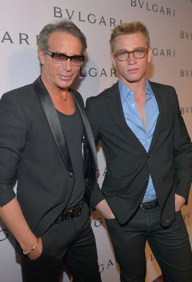 Fashion designer Lloyd Klein and Nick Gruber arrive at the BVLGARI celebration of Elizabeth Taylor's collection of BVLGARI jewelry at BVLGARI Beverly Hills on February 19, 2013 in Los Angeles, California. Photo: Charley Gallay, Getty Images For Bulgari / 2013 Getty Images
