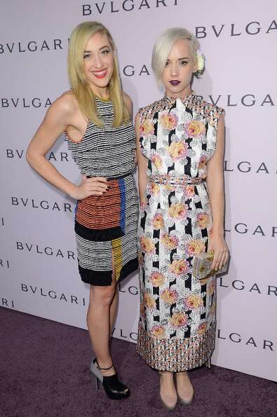 DJ Mia Moretti and musician Caitlin Moe arrive at the BVLGARI celebration of Elizabeth Taylor's coll