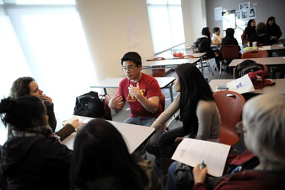 Jeffery Fang speaks with other students as they break into smaller groups during a meeting of the Alpha Gamma Sigma Honor Society at City College in San Francisco, CA Tuesday February 19th, 2013.   Jeffrey Fang is a 31-year-old student at City College of SF who will have completed about 80 units by the time he leaves at the end of this semester, which is over the 60 units needed to transfer to a four year school. Photo: Michael Short, Special To The Chronicle
