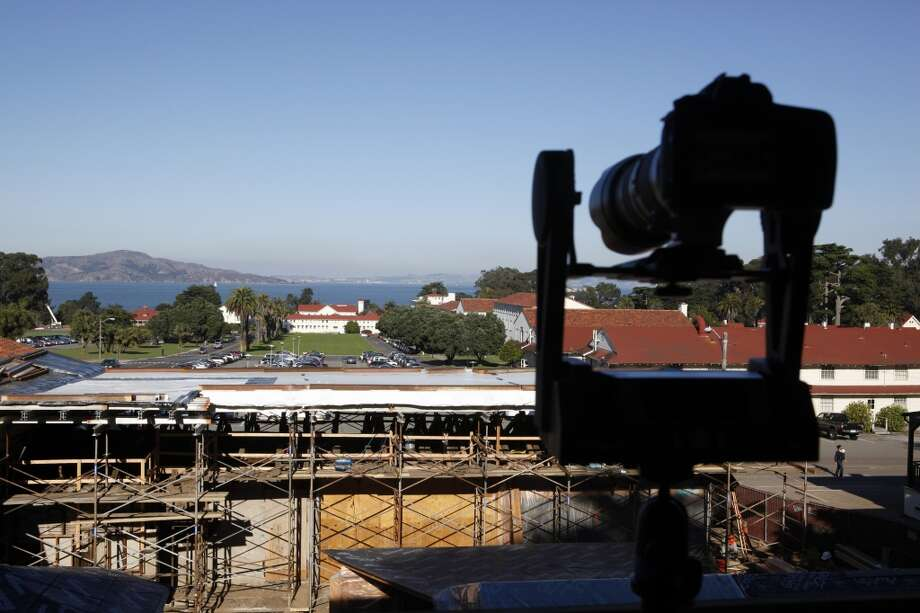 The Gigapan mount incrementally moves as the camera takes over a thousand images which combine to make a panoramic image of the renovation of the Officer's Club in the Presidio.