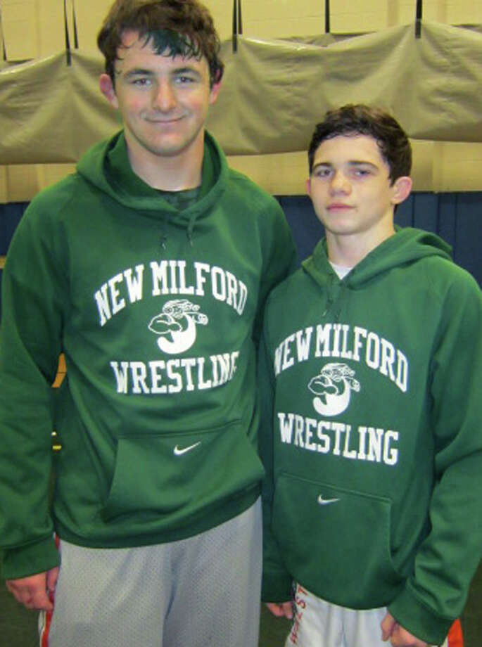 The Green Wave's Rob Tozzi, left, and Kyle Lindner sparked the New Miford High School  wrestling team to itsstate class 'L' championship Feb. 14-15 in Bristol by wining respective titles at 220 and 113 pounds. Photo: Norm Cummings