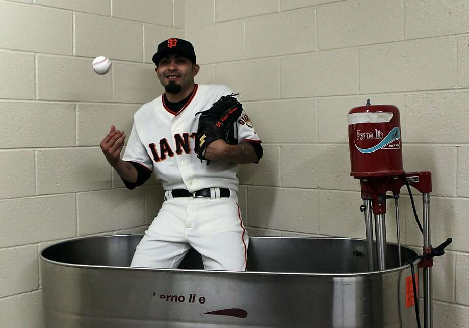 Some guys just don't like to get naked in front of other guys: Sergio Romo is so shy, he takes his whirlpool baths in full uniform. (Spring training, Scottsdale, Ariz.) Photo: Lance Iversen, The Chronicle