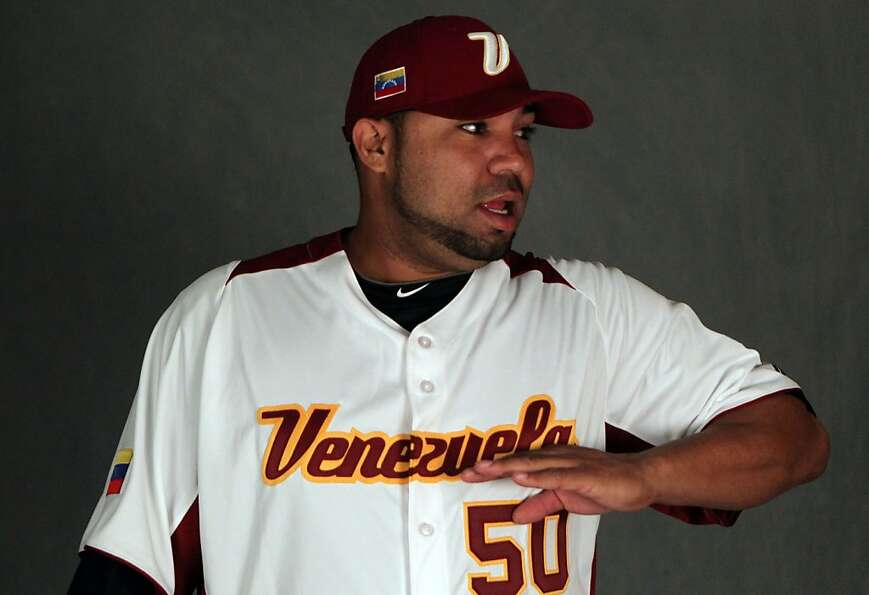 San Francisco Giants pitcher Jose Mijares poses in his World Baseball Classic jersey that he will we