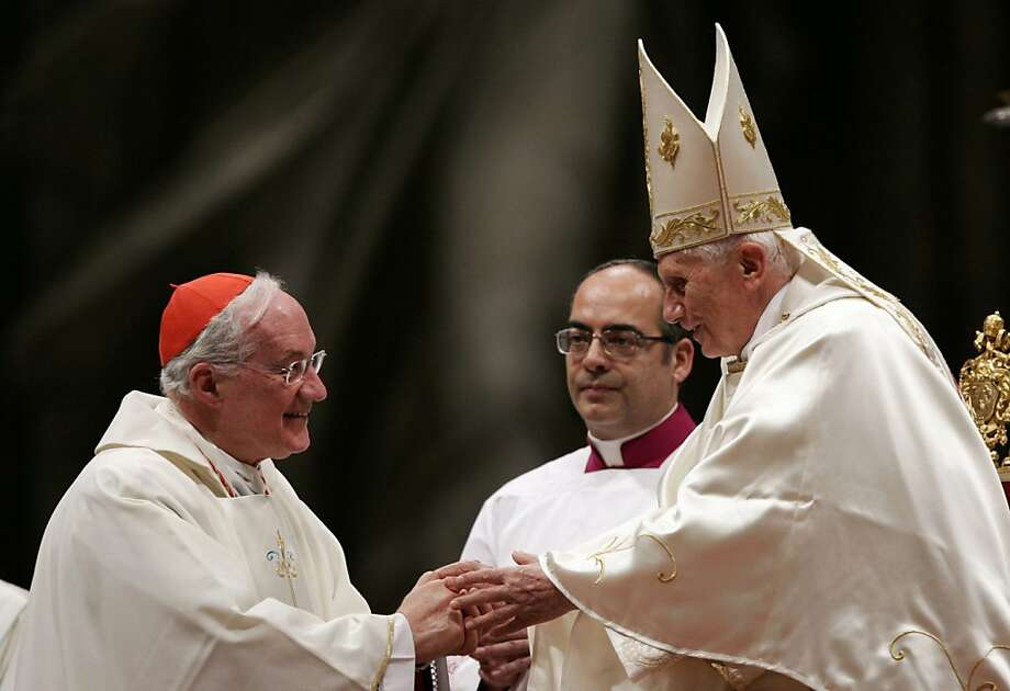 Cardinal Marc Ouellet of Canada (left) greets Pope Benedict at St. Peter's Basilica in 2011. He is among the favorites to replace the retiring pontiff. Photo: Riccardo De Luca, Associated Press