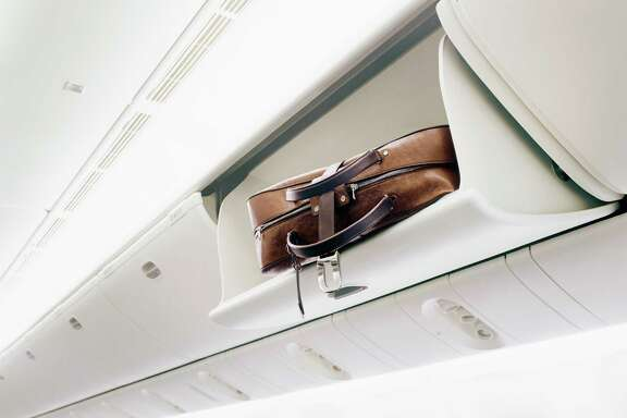Suitcase in an Airplane's Overhead Bin