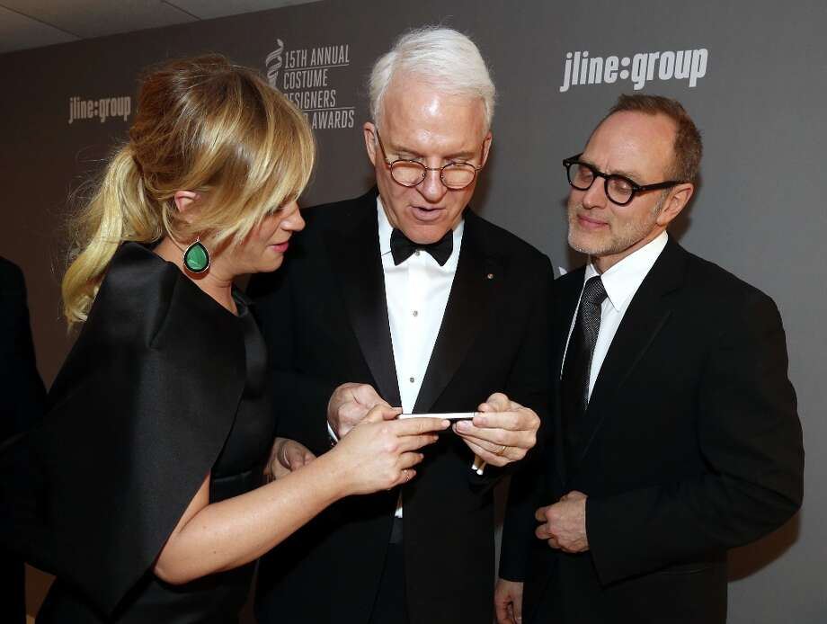 (L-R) Presenters Amy Poehler and Steve Martin and costume designer Tom Broecker attend the 15th Annual Costume Designers Guild Awards with presenting sponsor Lacoste at The Beverly Hilton Hotel on February 19, 2013 in Beverly Hills, California. Photo: Christopher Polk, Getty Images For CDG / 2013 Getty Images