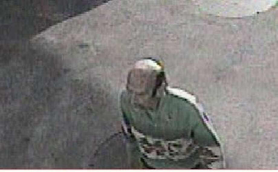 Authorities say this surveillance photo shows Francis Dwyer, 65, at a St. Helena gas station one day before three men were found shot to death in Forestville, Sonoma County, on Feb. 5, 2013. Dwyer and his son have been arrested in connection with the killings. Photo: Sonoma County Sheriff
