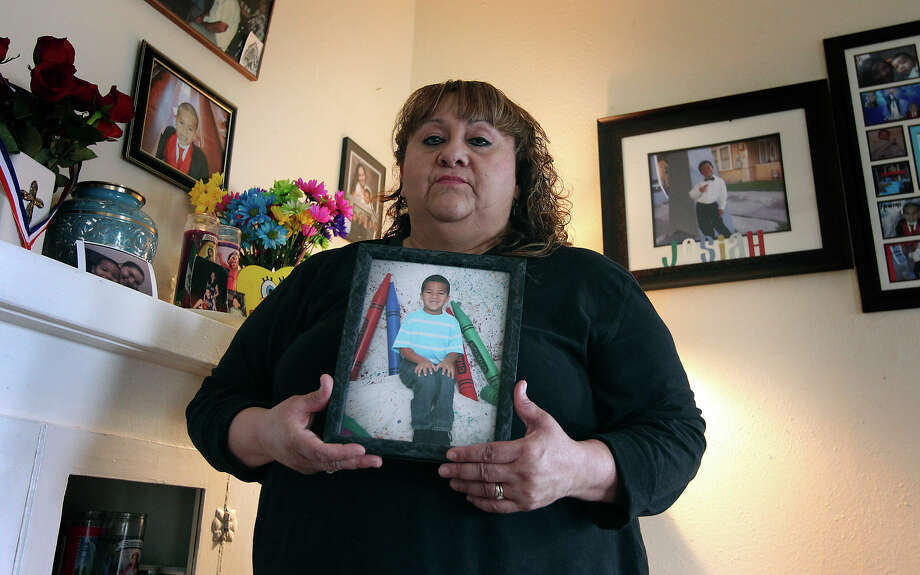 Patty Ojeda-Quintero, the biological grandmother of Josiah Williams, holds a portrait of the five-year-old at her home on Wednesday, Feb. 20, 2013. In a corner of her home, other photos and an urn holding the ashes of Williams is kept in remembrance. Williams was found deceased in his home in December 2012 and his parents were arrested and charged with felony injury to a child. Photo: Kin Man Hui, San Antonio Express-News / © 2012 San Antonio Express-News