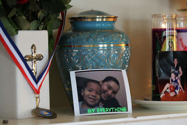 An urn holding the ashes of Joshiah Williams sits on a mantle in the home of his biological grandmother, Patty Ojeda-Quintero, on Wednesday, Feb. 20, 2013. Williams was found deceased in his home in December 2012 and his parents were arrested and charged with felony injury to a child. Photo: Kin Man Hui, San Antonio Express-News / © 2012 San Antonio Express-News