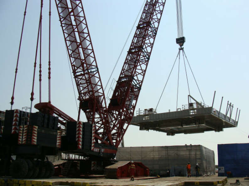 The rig's lower substructure is lifted during construction at the Lonestar Energy Fabrication yard i
