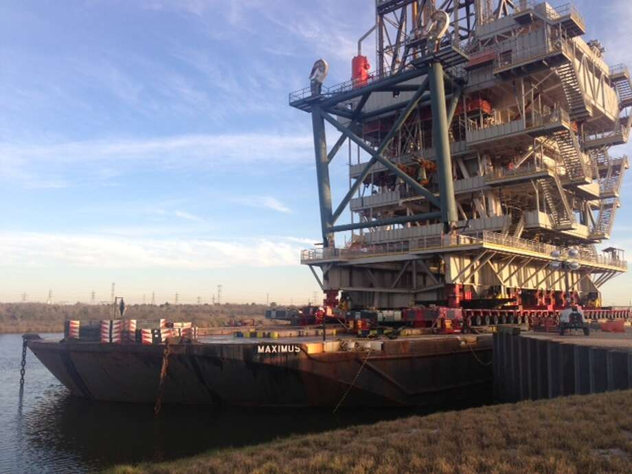 The rig is secured on a barge near Baytown, Texas. It will make a four-day, 250-mile journey to Ingleside, Texas to be mated with Royal Dutch Shell's Olympus offshore oil platform for use in the deep-water Gulf of Mexico.