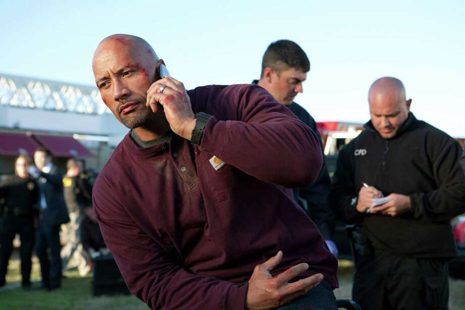"Dwayne Johnson plays a man with a successful business who gets involved in a scheme to rescue his son from an unjust prison sentence in ""Snitch."" Photo: Summit Entertainment"