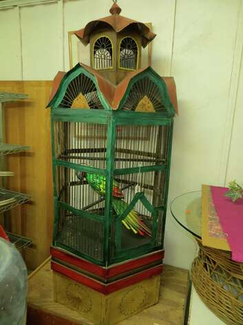 Capitol Antiques has this brightly colored birdcage. Photo: Jennifer Rodriguez