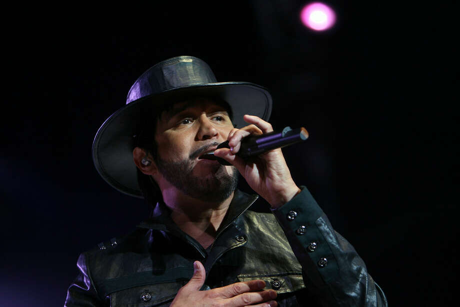 La Mafia's lead singer, Oscar De La Rosa, performs during the band's 30th anniversary concert at the Alamodome in 2010. Photo: Express-News File Photo