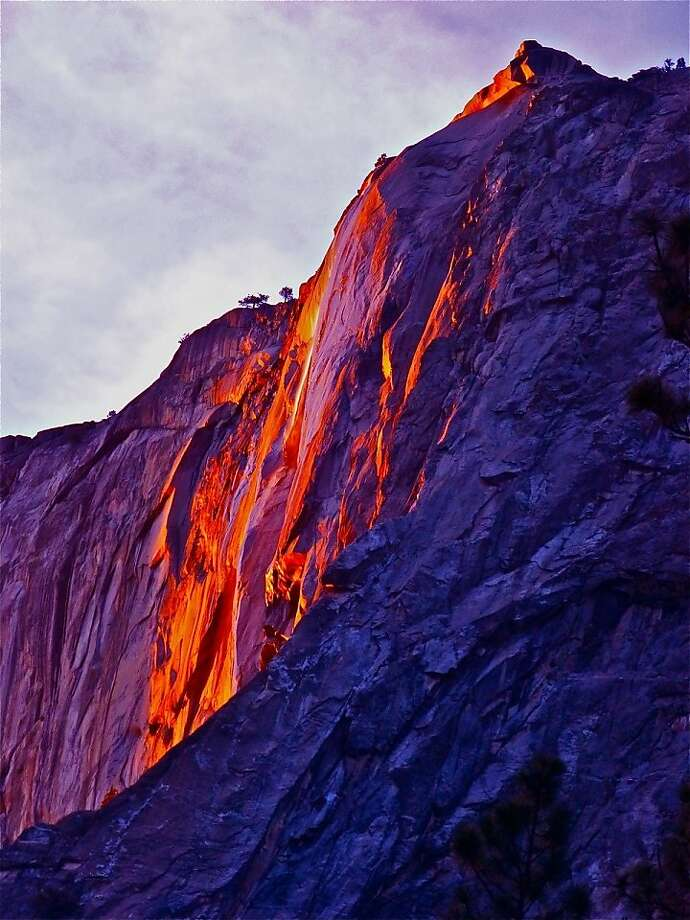 "Horsetail Fall looks more like an oil painting during a once-a-year convergence of light and weather conditions that causes the ""firefall."" It happened Saturday and could again this month. Photo: Lee DeCovnick, Courtesy Photo"