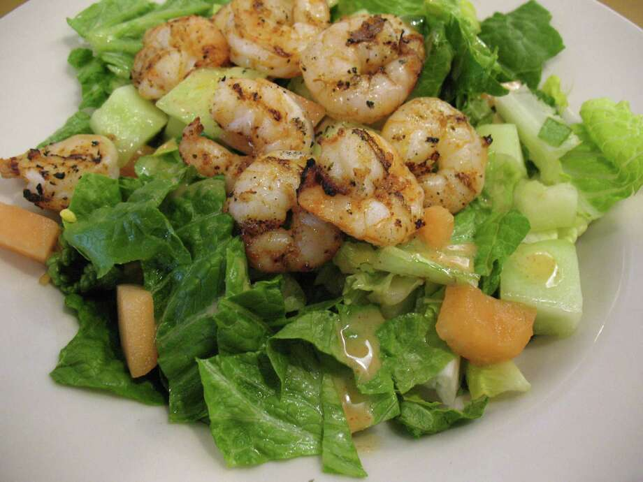 With its pleasing grilled flavor and spicy dressing, the Spicy Shrimp & Melon Salad stands out at the restaurant's location on  Loop 1604. Photo: Photos By Jennifer McInnis / San Antonio Express-News