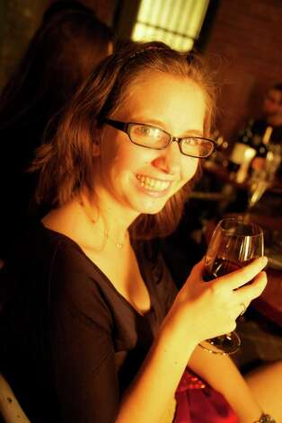 Lisa Perrakis enjoys a glass of wine.