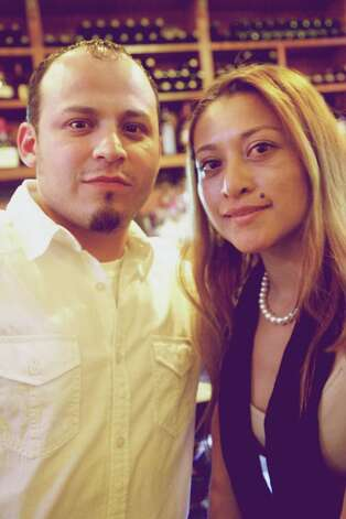 Jose Solis and Yesenia Calzada have drinks after work.