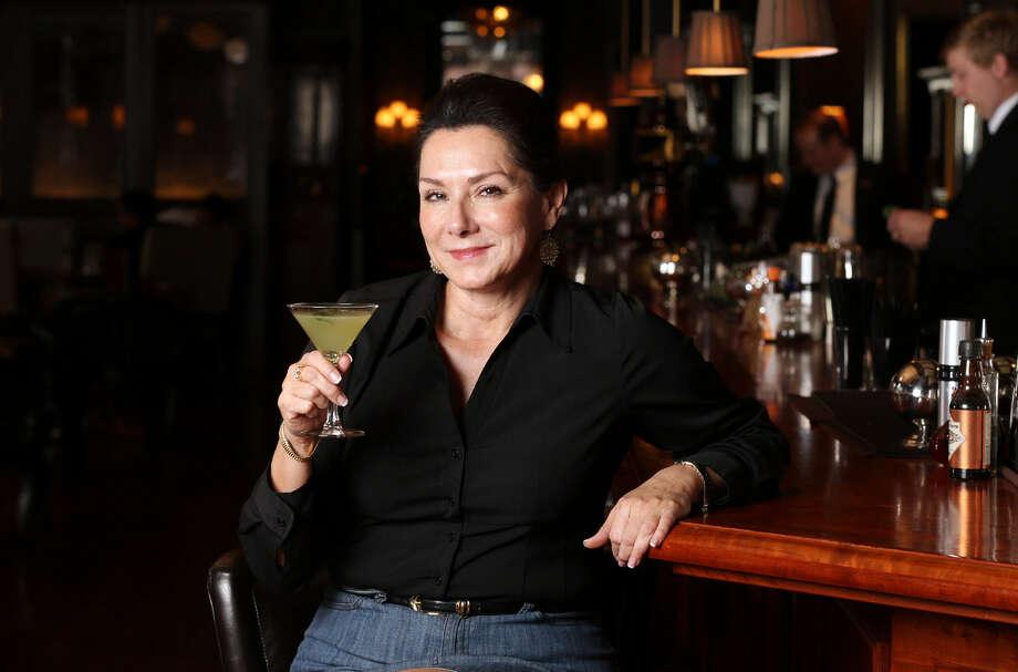 JoAnn Boone shows off the Rio Blanco cocktail. Photo: Edward A. Ornelas / San Antonio Express-News