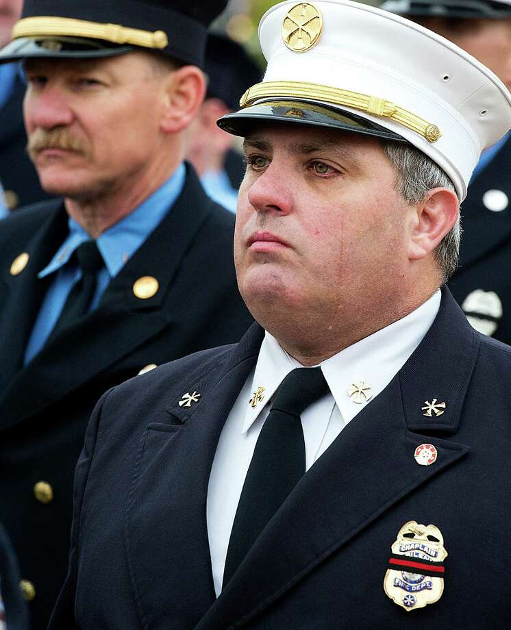 Chris Hale a fire chaplain from the Abilene Fire Department sheds a tear while walking in a procession at the memorial service for Bryan firefighters Eric Wallace and Gregory Pickard at Central Baptist Church in Bryan, Texas, Wednesday, Feb. 20, 2013. Photo: Stuart Villanueva, Associated Press / The College Station Eagle