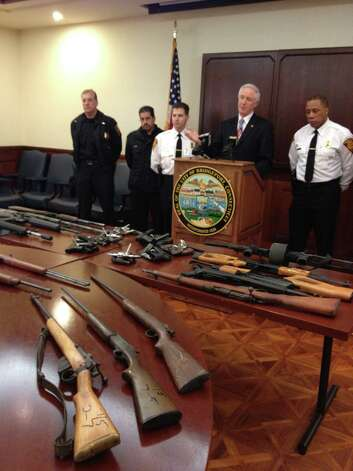 Standing in front of an array of weapons, Mayor Bill Finch, Assistant Police Chief James F. Nardozzi and members of the Bridgeport Police Department heralded the success of the CityâÄôs largest gun buyback program, which to date has taken nearly 700 guns off the streets during eight sessions held since Dec. 21, 2012.  Mayor Finch today announced that the program, which took a brief hiatus during the recent snowstorm, will resume on Saturday, March 2. From left, Lieut. Albert Karpus, Officer Nick Ortiz, Assistant Police Chief James Nardozzi, Mayor Bill Finch and Capt. Roderick Porter. All guns on the table were turned in during the first six weeks of the CityâÄôs largest-ever gun buyback program. Photo: Contributed Photo / Connecticut Post Contributed