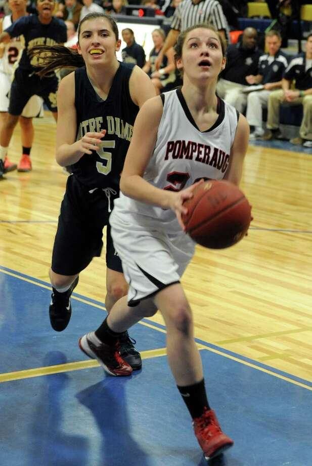 Pomperaug's Hannah Metcalf eyes the net against Notre Dame during SWC girls high school basketball semi-final action at Notre Dame High School, in Fairfield, Conn., Feb. 20th, 2013. Photo: Ned Gerard / Connecticut Post