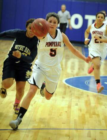 Pomperaug's Morgan Metcalf during SWC girls high school basketball semi-final action against Notre Dame, at Notre Dame High School, in Fairfield, Conn., Feb. 20th, 2013. Photo: Ned Gerard / Connecticut Post