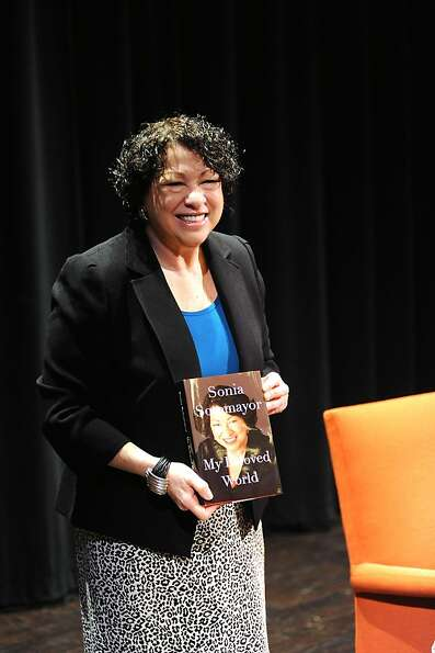 Justice Sotomayor holds a copy of her book