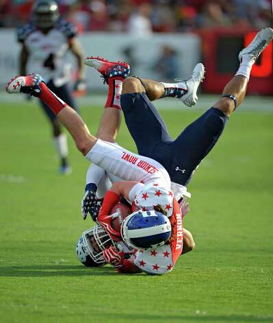 Senior Bowl South Squad wide receiver Conner Vernon (82) of Duke, is flipped up by Senior Bowl North Squad defensive back Dwayne Gratz of Connecticut  after pass reception during first quarter of the Senior Bowl NCAA college football game at Ladd-Peebles Stadium in Mobile, Ala., Saturday, Jan. 26, 2013 (AP Photo/G.M. Andrews) Photo: G.M. Andrews, Associated Press / FR35697 AP