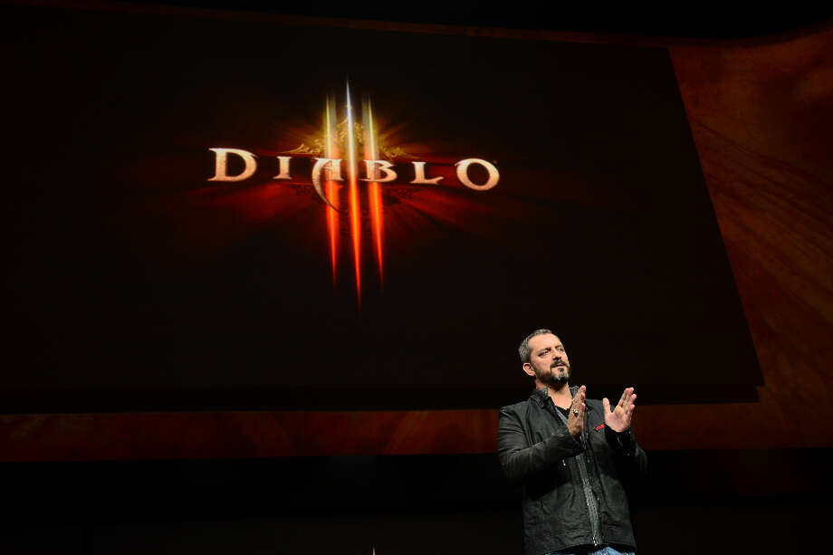 Christopher Vincent Metzen of Blizzard Entertainment talks as Sony introduces the PlayStation 4 at a news conference February 20, 2013 in New York.  AFP PHOTO/EMMANUEL DUNANDEMMANUEL DUNAND/AFP/Getty Images Photo: EMMANUEL DUNAND, AFP/Getty Images / AFP