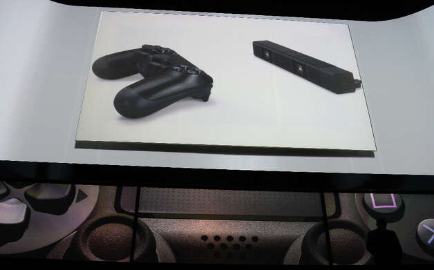 Game controler shown on the screen as Sony introduces the PlayStation 4 at a news conference February 20, 2013 in New York.  AFP PHOTO/EMMANUEL DUNANDEMMANUEL DUNAND/AFP/Getty Images Photo: EMMANUEL DUNAND, AFP/Getty Images / AFP