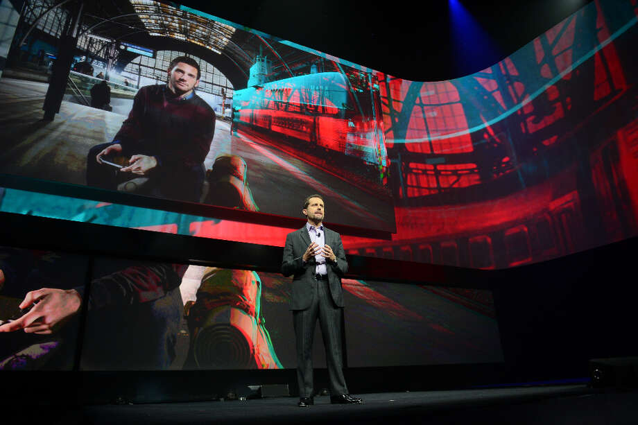 Sony's Andrew House, current president and Group CEO of Sony Computer Entertainment, introduces the PlayStation 4 at a news conference February 20, 2013 in New York.  AFP PHOTO/EMMANUEL DUNANDEMMANUEL DUNAND/AFP/Getty Images Photo: EMMANUEL DUNAND, AFP/Getty Images / AFP